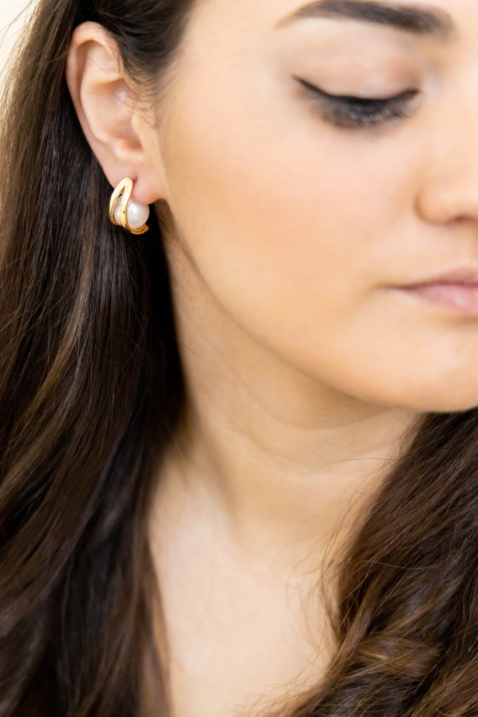 Gold earrings on model