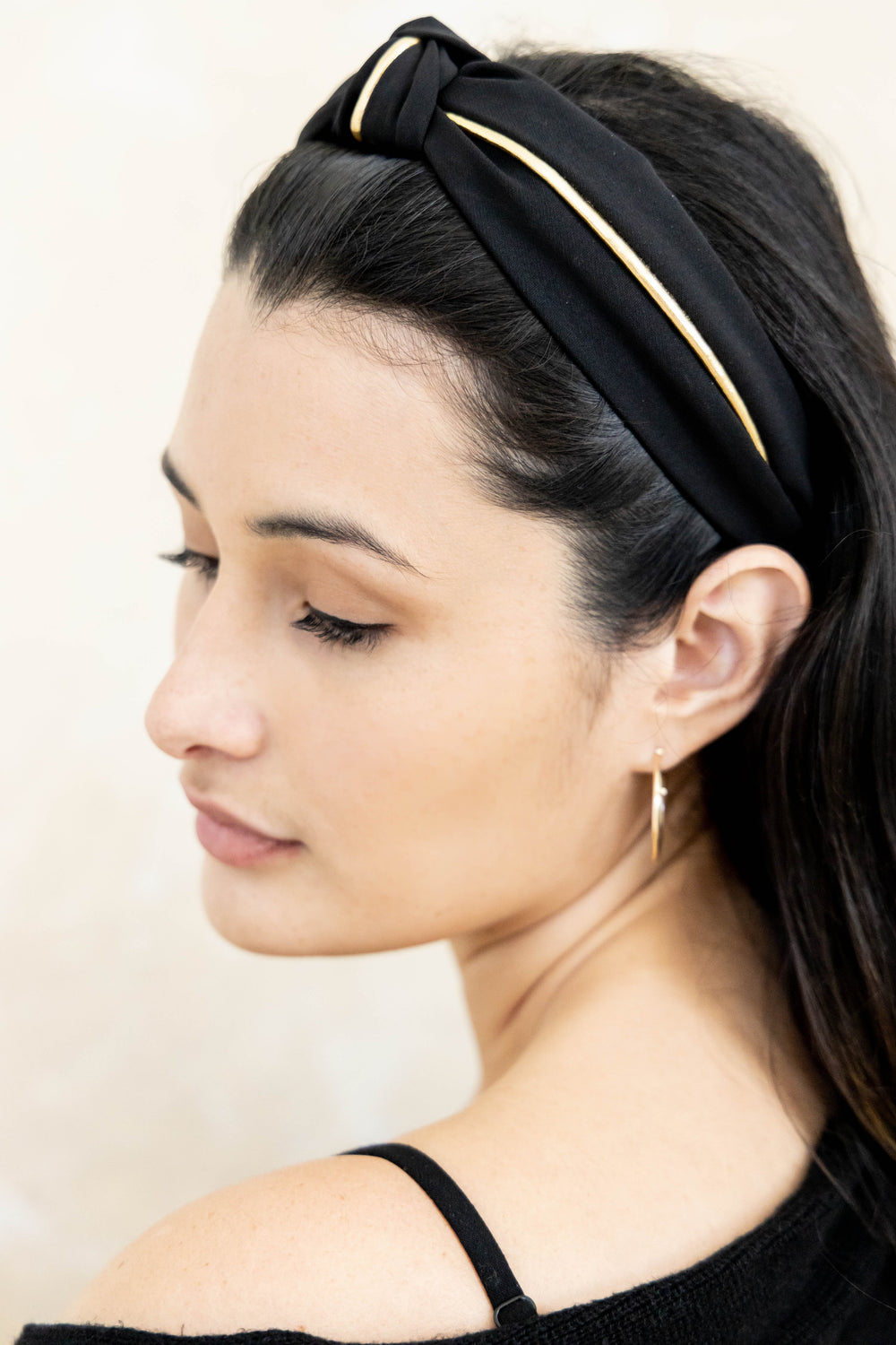 Black and gold headband on model