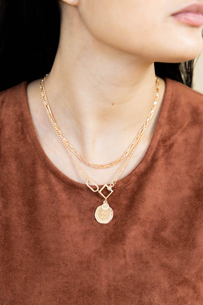 Gold necklace trio with coin on model