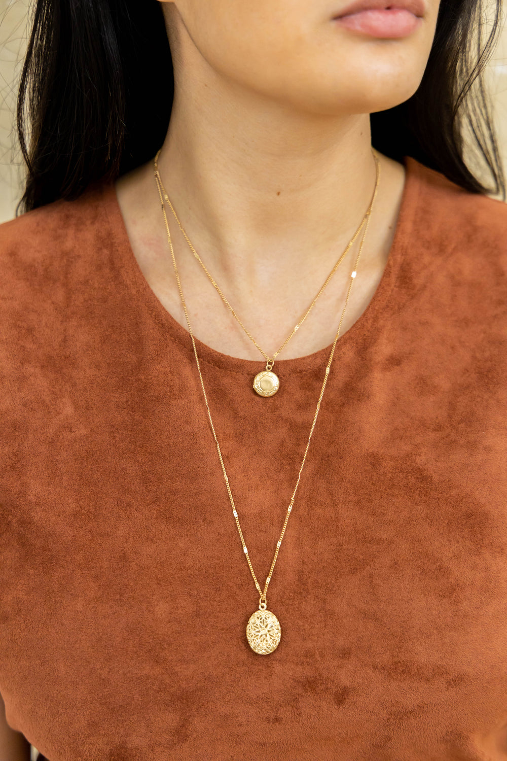 Gold pendant necklace on model
