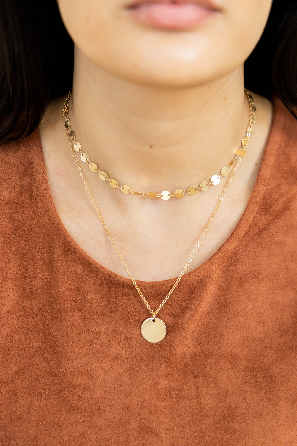 Gold layered necklace with choker on model