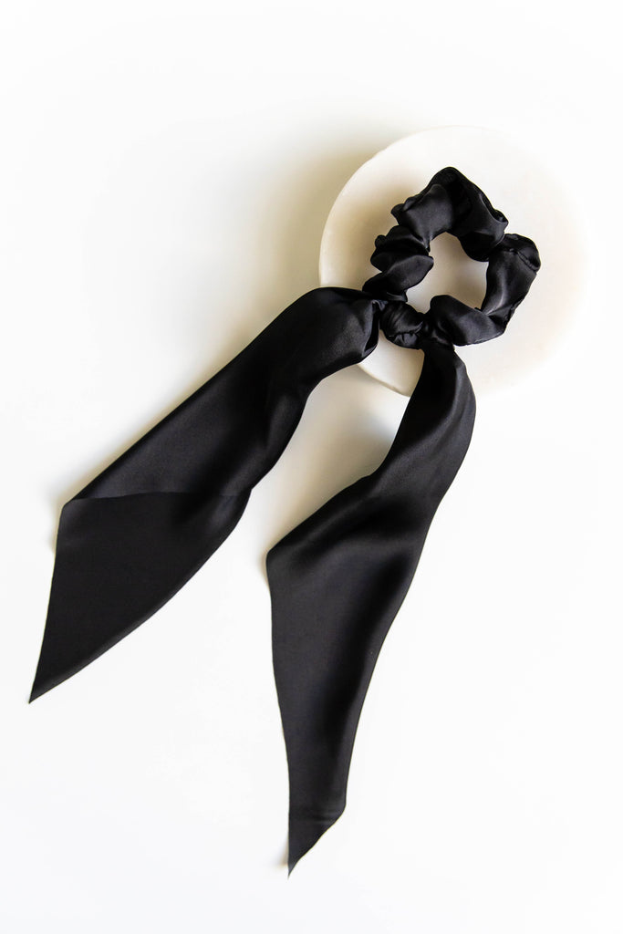 Black scrunchie on white background
