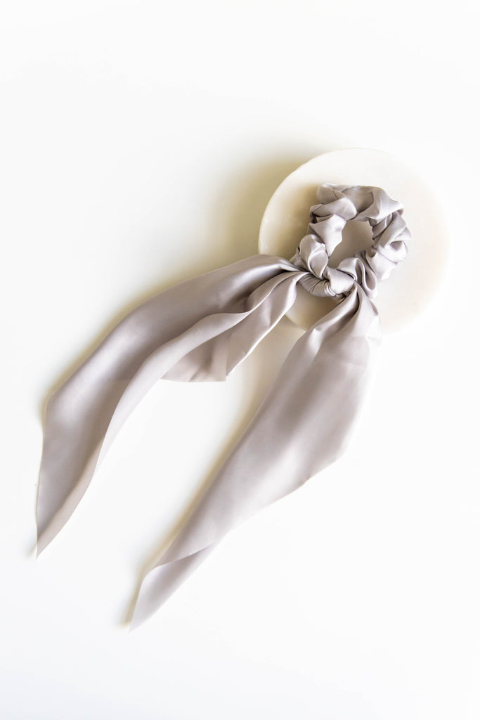 Grey scrunchie on white background