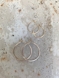 small continuous hoops (gold or silver)