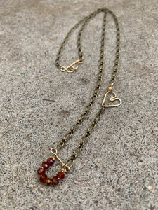 Hessonite garnet with gold heart