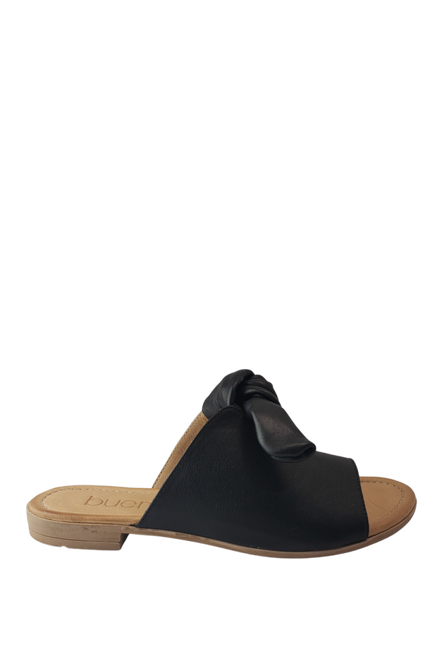 JOLEY BLACK BUENO  https://shoptrixie.com/products/joley-black-bueno  Surely we're not the only suckers for a keyhole detail and a sweet little bow? The Joley from Bueno Footwear takes a classic slide from basic to anything but. Yes, it's okay for comfort to look this cute.