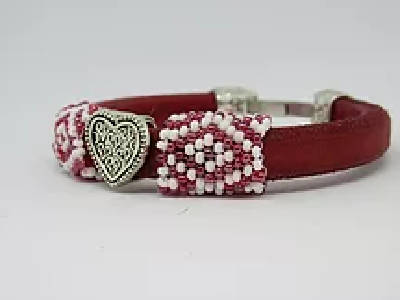 Red regaliz leather band with hand beaded sleeves