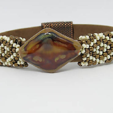 Light brown leather-suede flat bracelet with hand beaded gold-white sleeves