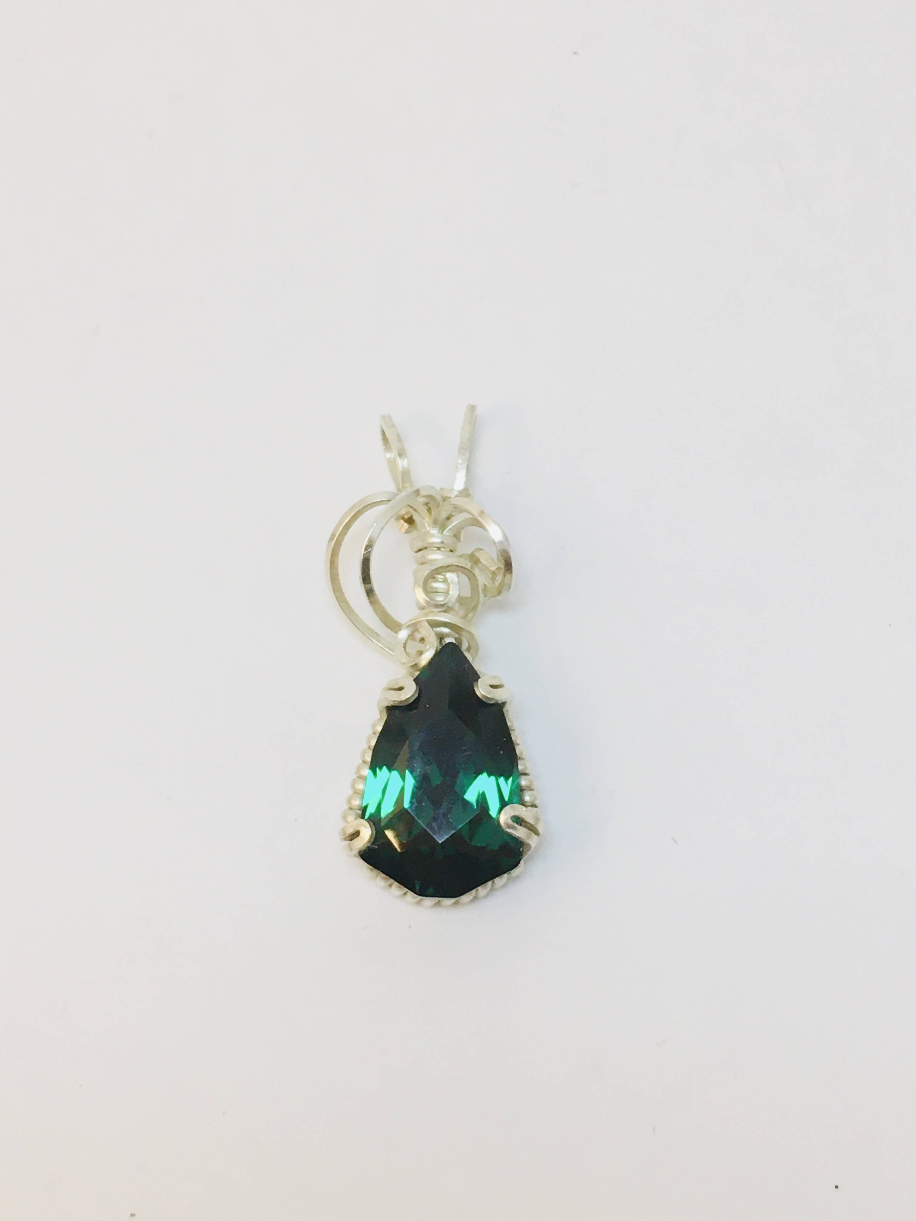 Emerald Swarovski pendant wire wrapped with sterling silver .935
