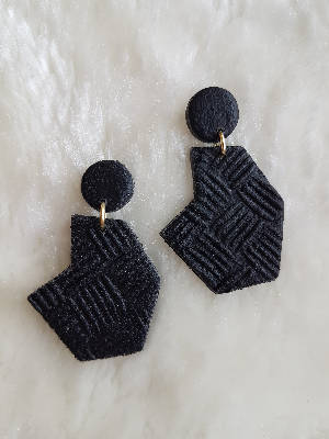 Black leather puzzle earrings