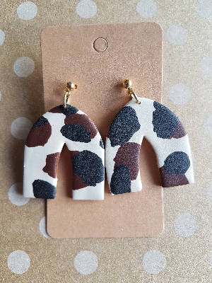 Animal print - chocolate cow arch earrings