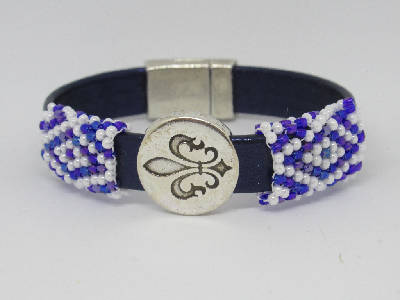 Navy leather flat band bracelet with hand beaded blue-purple-white sleeves
