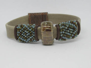 Leather-suede flat tan bracelet with hand beaded brown-light blue sleeves