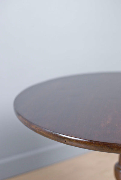 Circle topped Mahogany Occasional tripod table on turned legs c80 years old