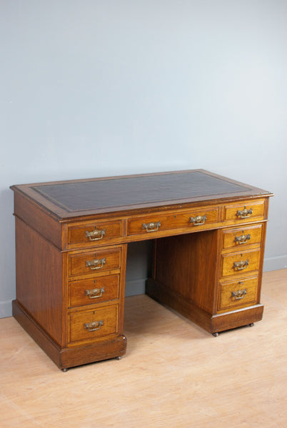 Medium sized Walnut pedestal desk with burgundy leather, Victorian c180 years old