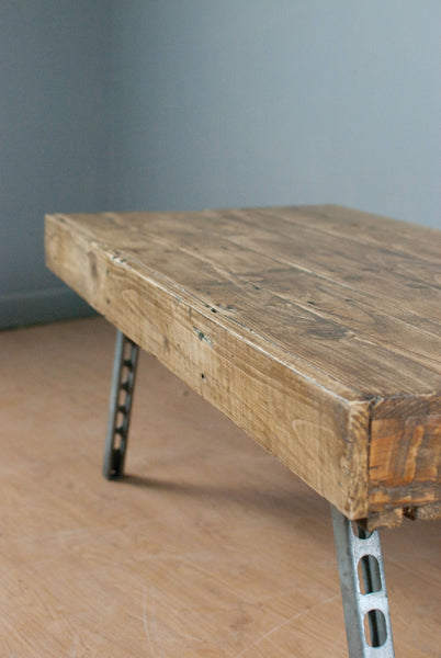 Large reclaimed pine coffee table on steel legs. Industrial Chic