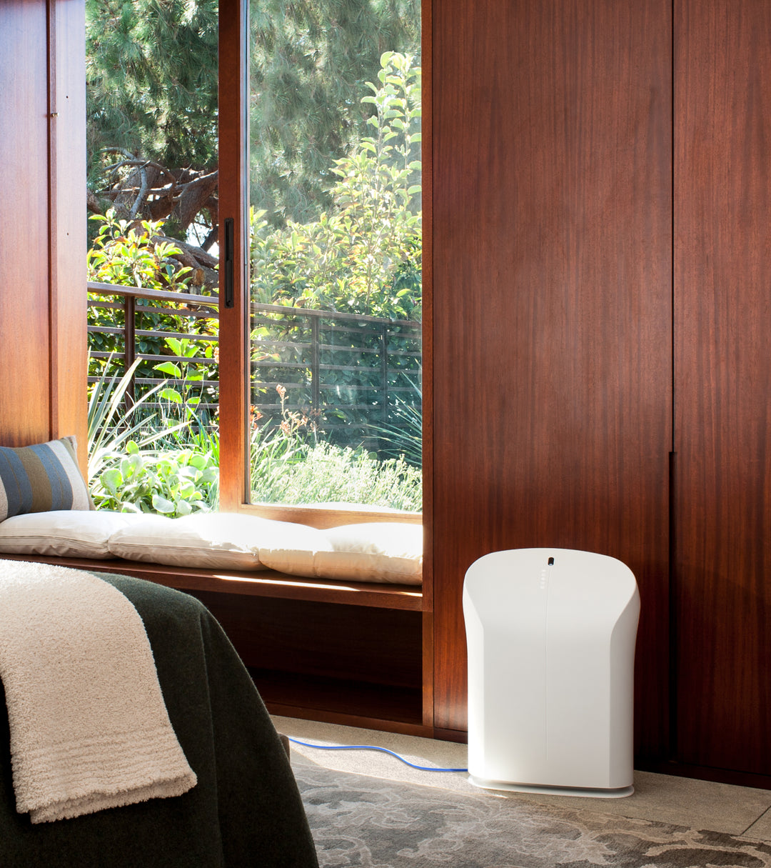 BioGS 2.0 air purifier sitting by the bed