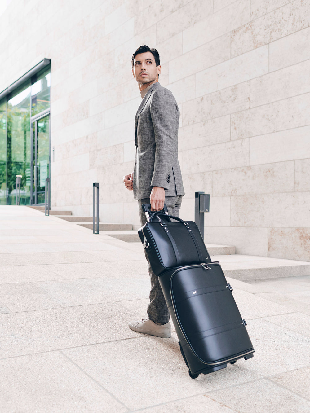 f38 leather carry-on luggage with f25 business briefcase in black leather schwarzes leder