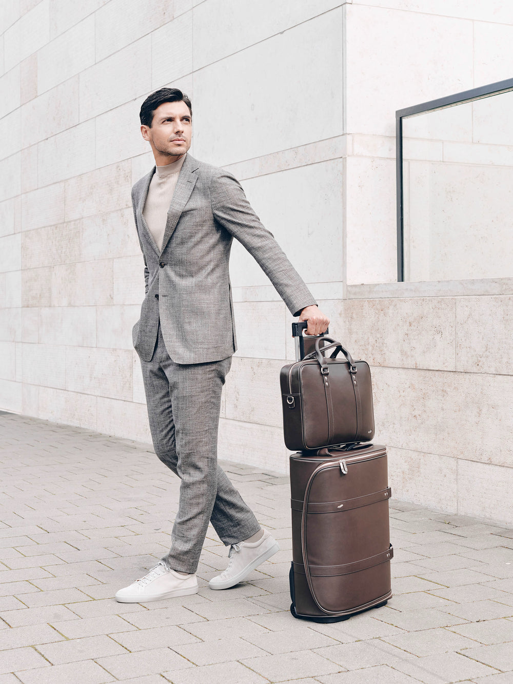 male model with f38 brown leather carry-on luggage and f25 business briefcase brown leather braunes leder