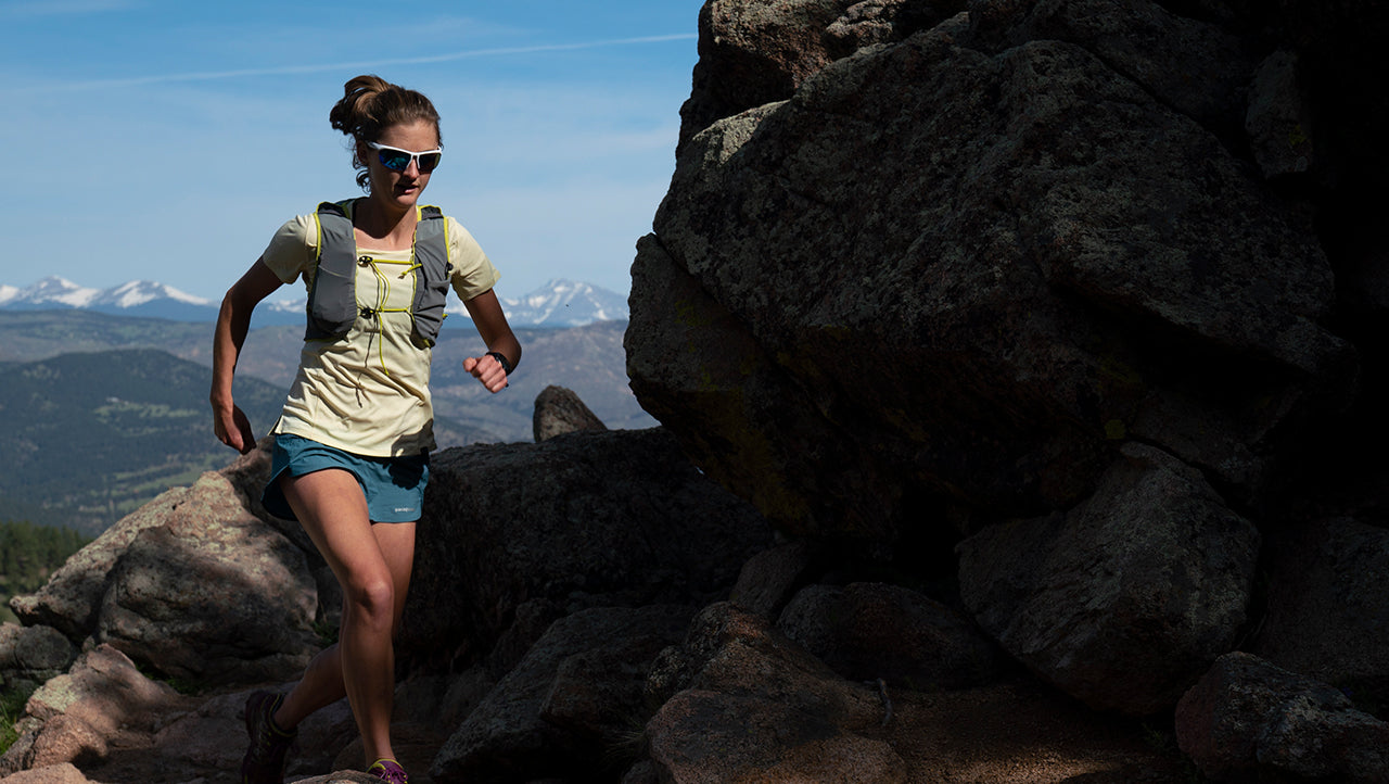 Clare Gallagher Running on a Mountain