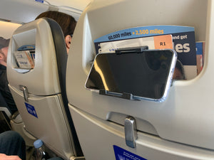 vuwing with phone in airline headrest