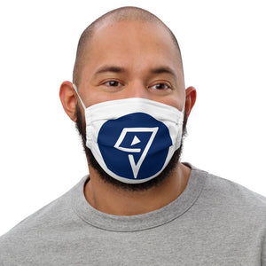 adult male with white face mask marked with a dark blue circle with the vuwing travel phone holder logo in white
