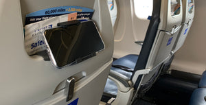 vuwing travel phone holder inserted in a cabin airplane headrest