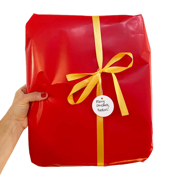Red wrapping paper with gold ribbon for jude and moo bags.
