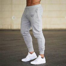 Load image into Gallery viewer, 2019 Fashion Men Gyms Pants Joggers Fitness Casual Long Pants Men Workout Skinny Sweatpants Jogger Tracksuit Cotton Trousers