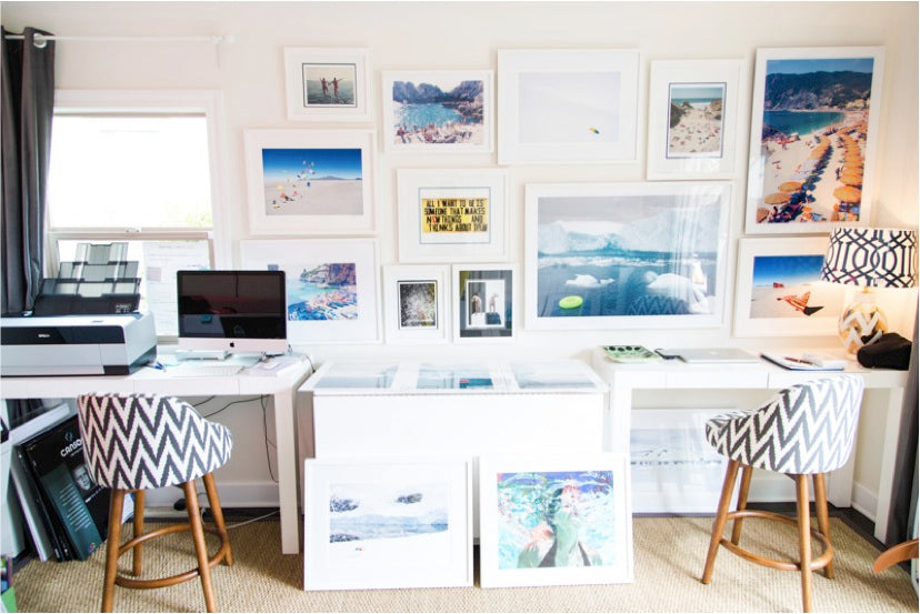 A gallery wall at the home of Gray Malin via Simply Framed