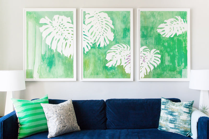 Orlando Soria's living room makeover featuring the work of Erika Gragg, framed by Simply Framed. Photos via Sean Gin