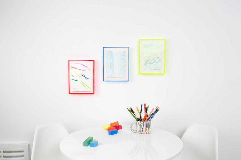 simply framed max plexibox in color neon gallery wall