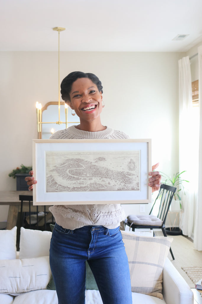Tiffany of pretty real with her custom framed map