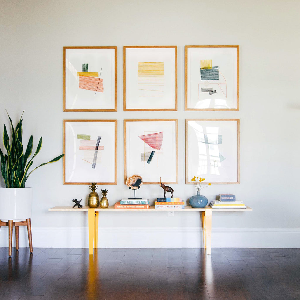 A mid-century gallery wall via Simply Framed