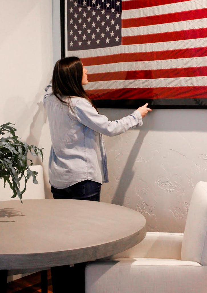 Simply Framed's Dara Segal hanging a very special American flag in her new home