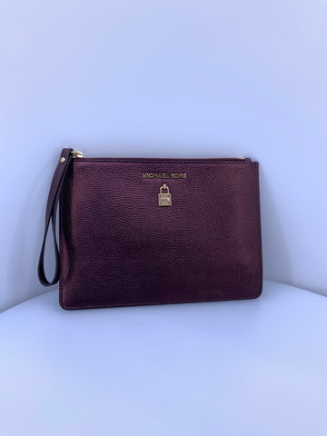 Michael Kors Wristlet plum color