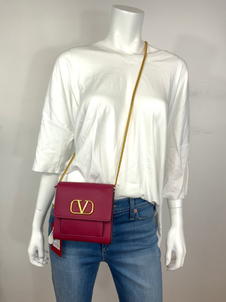 Valentino wallet crossbody in a fierce pink with a gold chain NEW