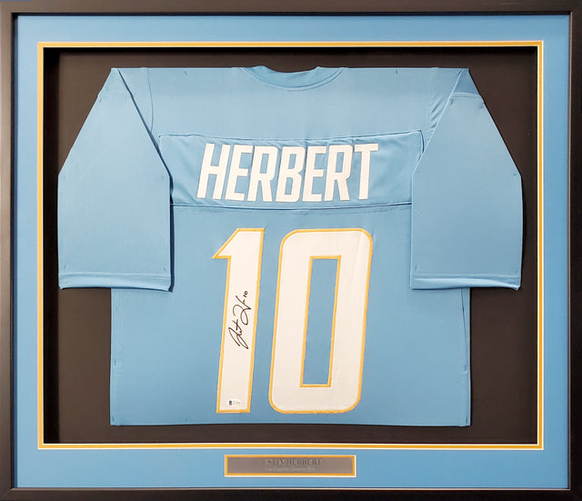 Los Angeles Chargers Justin Herbert Autographed Framed Powder Blue Jersey Beckett BAS Stock #191176