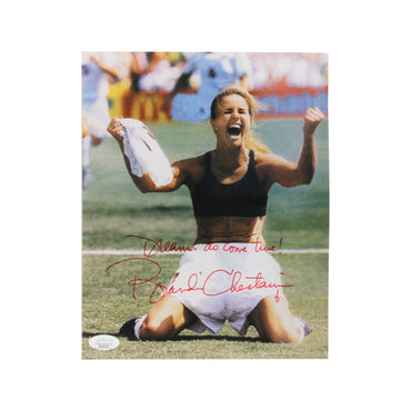 "Brandi Chastain Team USA Autographed 1999 World Cup Celebration 8x10 Photograph with ""Dreams Do Come True"" Inscription - Autographed in Red - (JSA Authenticated)"