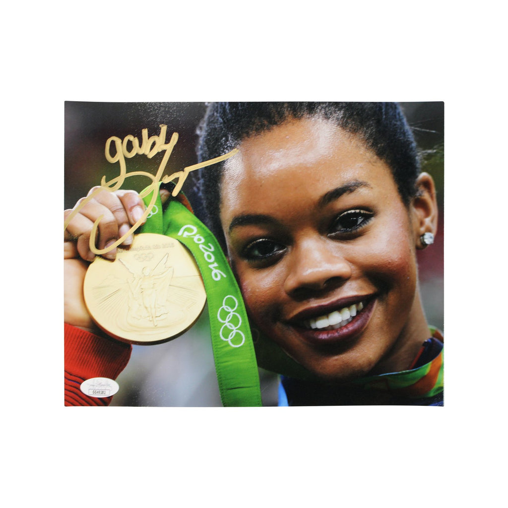 Gabby Douglas Team USA Autographed Holding 2016 Olympic Gold Medal 8x10 Photograph (JSA Authenticated)