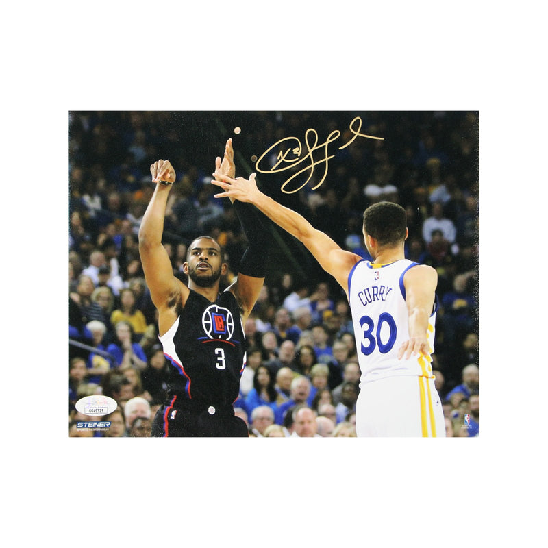 Chris Paul Los Angeles Clippers Autographed Jumper Over Curry 8x10 Photograph (JSA Authenticated)