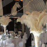 long Ortich feathers table decorations @elloirevents