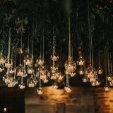 tea light candles dangling from the trees @elloirevents