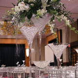 martini glasses filled with flowers and water balls. table decorations @elloirevents