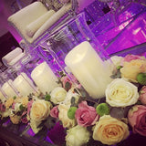 candle lit table decorations with flowers around. table centerpieces @elloirevents