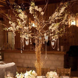 blossom tree centrepieces with dangling diamonds and tea lights @elloirevents