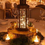 Warm fairy lights in lanterns table centerpieces decorations @elloirevents