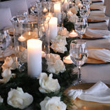 Long table filled with glasse vases and candles @elloirevents
