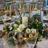 gold glass filled with tea lights and greenery table decorations @elloirevents