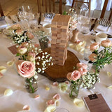 Jenga table decorations with games as the centerpieces @elloirevents